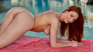 Get Sensual With Redhead Lacy Lennon As She Striptease At Poolside